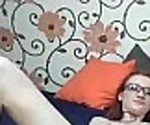 Redhead with Glasses toys her Pussy with a Di