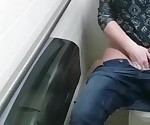 Big tit chick masturbates in public toilet